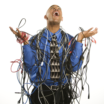 IT Support small business Man wrapped in cables.